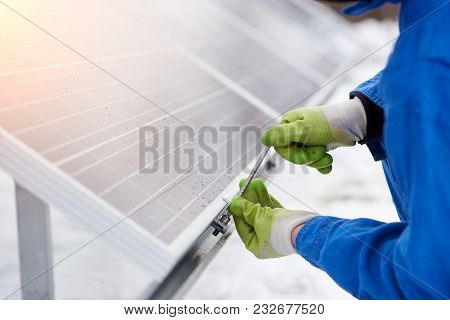 Cropped Close Up Of A Repairman Fixing Blue Solar Panel Module Outdoors Copyspace Photovoltaic Renew