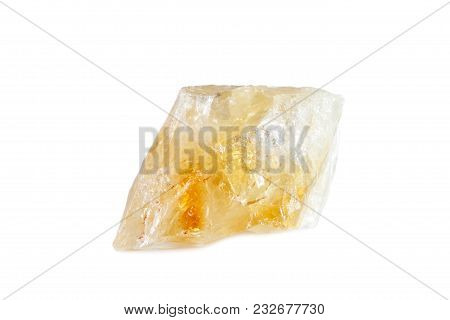 Macro Shooting Of Natural Gemstone. The Raw Mineral Is Citrine. Brazil. Isolated Object On A White B