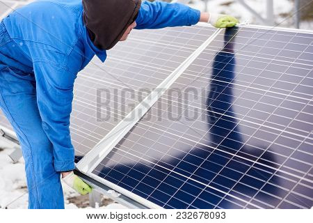 Horizontal Shot Of A Technician Worker Adjusting Solar Panel Outdoors Installing Photovoltaic System