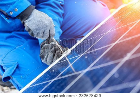 Close Up Cropped Shot Of A Technician Worker Using Screwdriver Installing Solar Panels Outdoors Alte
