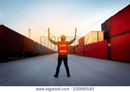 Foreman Control  Cargo Train By Light Baton  In The Container Yard Port International .