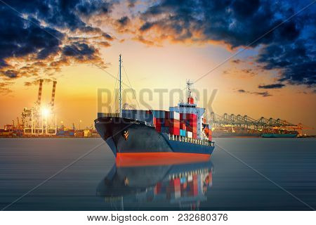 Cargo Ship Carrying Container And Running For Export  Goods  From  Cargo Yard Port To Other Ocean Co