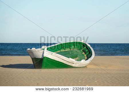 Malvarrosa Valencia Spain, Malvarrosa Valencia Spain Wrecked Wooden Boat. Boat Stranded In The Sand