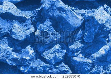 Horizontal Stone Wall Of A Nature Rock - Close Up. Toning In Pantone Color Marina.