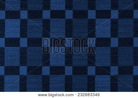 Fabric Background With Geometric Patterns. Close-up. Toning In Pantone Color Navy Peony.
