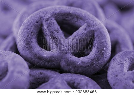 Abstract View Of A Pretzel With Blurred Bokeh. Toning In Pantone Color - Ultra Violet. Macro.