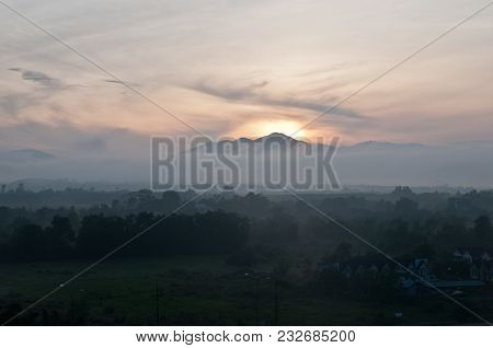 Early Morning Dawn In Middle Of Cloudy Jungle In Trung City In Thailand