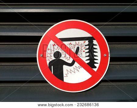 Warning Sign Electrocute Danger Notice On Metal Sheet Wall