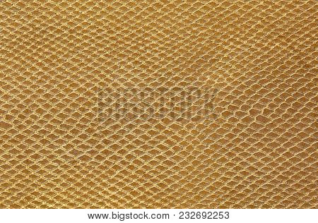 Background Of Scales Similar To Snakeskin In Gold Color
