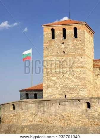 towers of Baba Vida fortress and waving bulgarian flag in Vidin