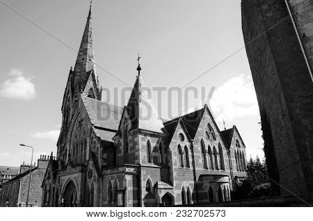An Exterior View Of A Church With Spire In Dundee