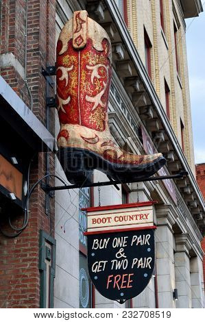 Nashville, Tennessee, Usa - March 19, 2018: Boot Country Store Sign At Lower Broadway Area Advertisi