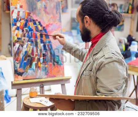 Artist Create His Picture In Studio. Home Studio, View From Back