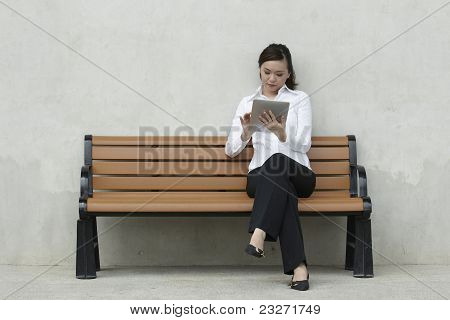 Asian Business women using a Touch-pad PC