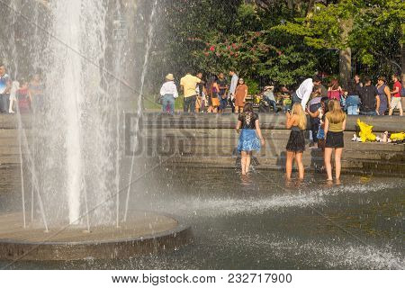 People Relaxing In The Washington Square Park In Summer, Sunny Day.