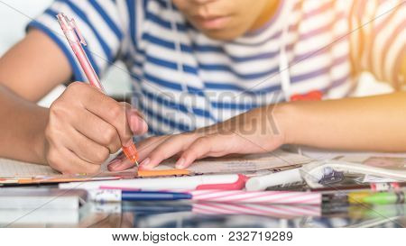 Education, Back To School And Literacy Day Concept With Girl Kid Student Studying Doing Homework Wri