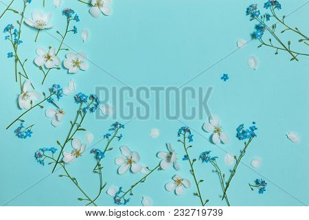 Spring Aqua Blue Background With White Blooming Apple And Forget-me-not Flowers, Close-up Top View,