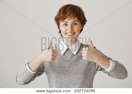 Girl Is Thrilled With Excellent Idea. Indoor Shot Of Excited Upbeat Woman With Ginger Hair And Freck