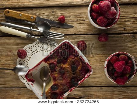 Cottage Cheese Casserole With Raisins And Raspberries On A Wooden Background In Rustic Style - Top V