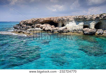Sea Caves Of Cavo Greco Cape. Ayia Napa, Cyprus. Mediterranean Sea Landscape