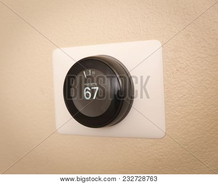 Black, Round Thermostat With Digital Screen Reading