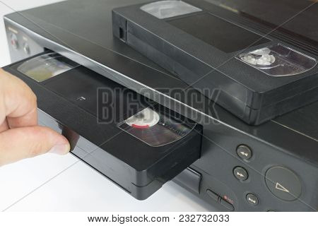 Vhs Videocassette Is Put Into The Video Recorder To Watch The Video, Another Video Cassette Is On Th