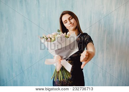 Woman Is Holding Bouquet Of Roses, Showing Bad Sign - Dislike. Concept Is Bad, Disgusting Bouquet.