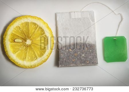 Teabag And Slice Of Lemon Of Close-up On A White Isolated Background And Ready Free Space Copyspace