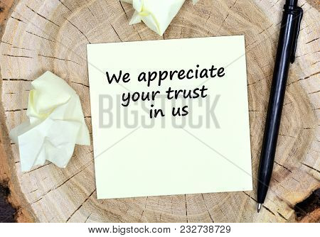 We Appreciate Your Trust In Us. Text On Paper On A Wooden Table