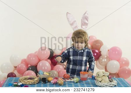 Easter Eggs, Child With Easter Decorations For The Holiday. Handsome Cute Boy Is Played With Toy Egg