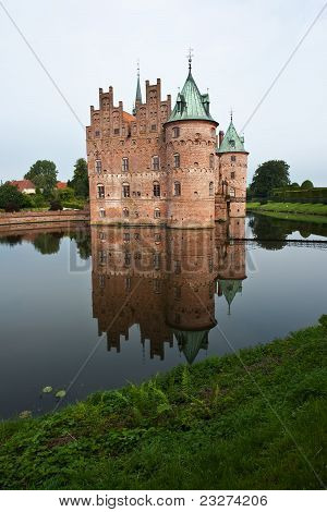Egeskov castle slot landmark fairy tale castle in Funen Denmark vertical view poster