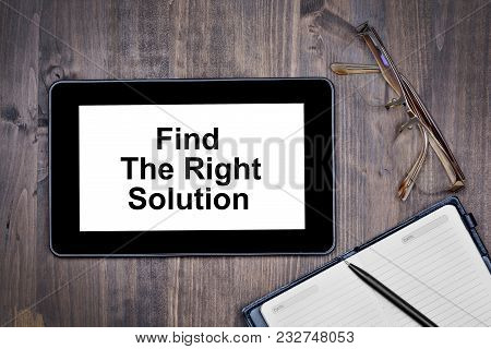 Find The Right Solution. Text On Tablet Device On Desk Close-up
