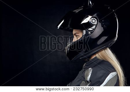 Profile Portrait Of Fashionable Young European Woman Rider With Blonde Hair Preparing For Motor Race