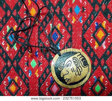 Traditional Embroidery Of The Ancient People Of South America - Maya. In The Frame, Red Canvas And A