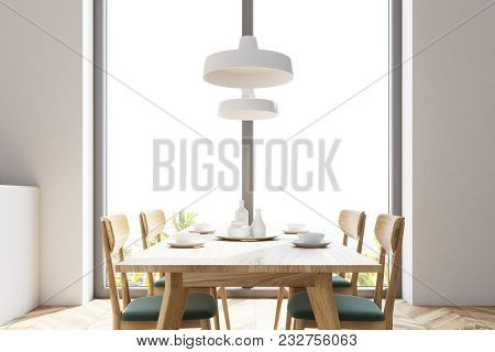 White Panoramic Dining Room And Kitchen With A Wooden Floor And A Long Wooden Table With Chairs Near