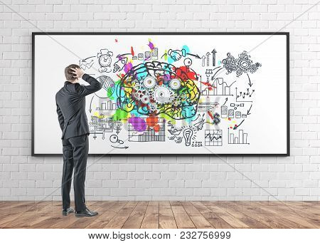 Rear View Of A Confused Businessman Scratching His Head And Thinking. A Whiteboard Background With A