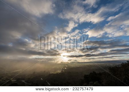 Los Angeles San Fernando Valley misty morning sunrise with clearing storm clouds at Santa Susana Pass State Historic Park.