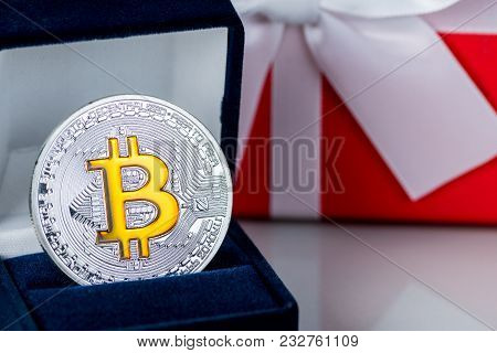 Christmas Gift Or New Year With Ribbon And Best Gift Bitcoin Coin On Light Background. Cryptocurrenc