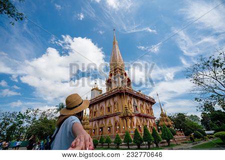 Young Woman Traveler Holding Hand Man Into Beautiful Pagoda In Wat Chalong Or Chalong Temple At Phuk