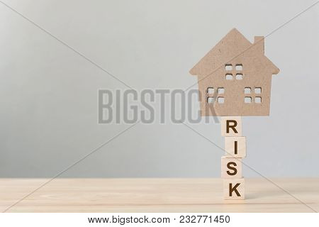 Property Investment And House Mortgage Financial. Risk Management Concept. Wooden Home On Wood Block