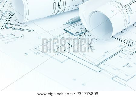 Architectural Project Plans And Roll Blueprints With Pencil And Ruler On Architect Workplace Table