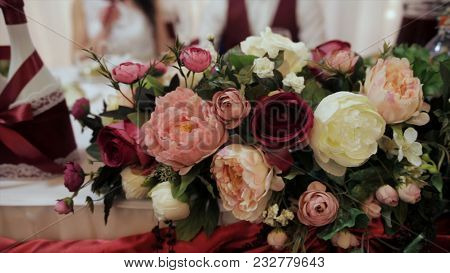 Beautiful Bouquet Of Rose Flowers, On Table. Wedding Bouquet From Red Roses. Elegant Wedding Bouquet