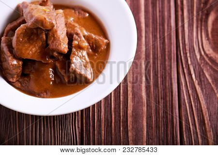 Veal Stew With Gravy In A Bowl
