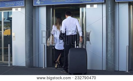 Young Couple Entering Elevator At Airport, Business Trip, Travel And Tourism, Stock Footage