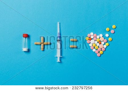 Pills Bottle Plus Empty Syringe Needle Equals Medication Colorful Round Tablets In Form Of Heart Iso