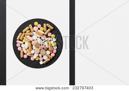 Medication White Colorful Round Tablets Arranged Abstract In Circle On White Black Background. Aspir