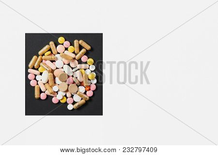 Medication White Colorful Round Tablets Arranged Abstract In Square On White Black Background. Aspir