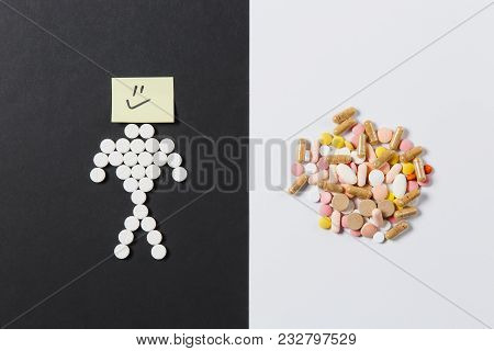Medication White Colorful Round Tablets Arranged Abstract On White Black Background. Human Smile, As