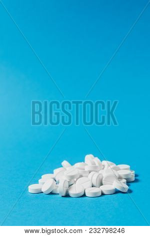 Medication Pile White Round Tablets Arranged Abstract On Light Blue Color Background. Aspirin, Capsu
