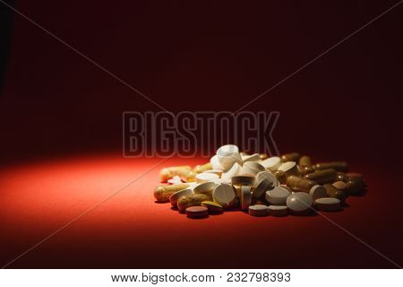 Medication White Colorful Round Tablets Arranged Abstract On Dark Red Color Background. Aspirin, Cap